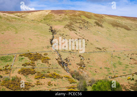Waterfall on hillside above valley seen from Snaefell railway. Laxey, Isle of Man, British Isles - Stock Image