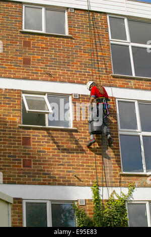 Abseiling in construction - Stock Image