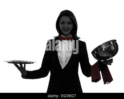 one  woman waiter butler opening catering dome in silhouette on white background - Stock Image