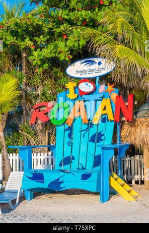 Beachside attraction an oversized beach chair on West Bay Beach Roatan Honduras. - Stock Image
