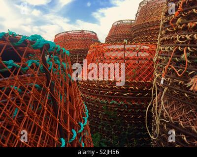 Crab traps stacked up in Cheticamp Cape Breton Island Canada - Stock Image
