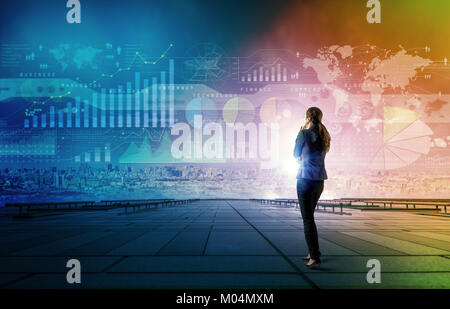 standing woman who looks various graphics of business. Internet of Things. Information Communication Technology. - Stock Image