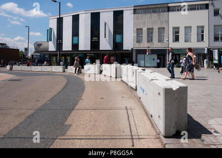 Concrete blocks at a pedestrianised area to protect shoppers, tourists from vehicles above bar Southampton Hampshire UK - Stock Image