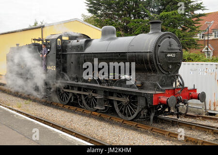 A preserved and restored  EX LMS 4f class steam powered locomotive at the West Somerset Railway`s Minehead station. - Stock Image