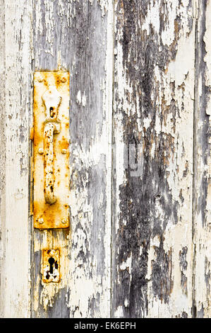 Rusty handle on an old wooden gate - Stock Image