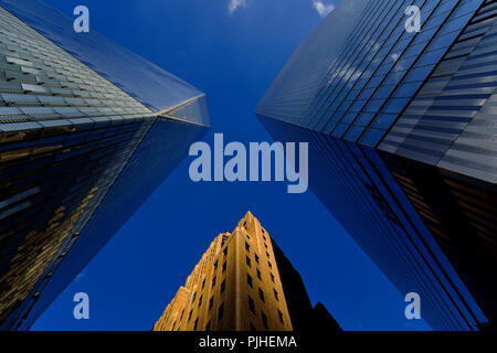 USA, New York, view against diving Tower of Liberty (1WTC) and two other buildings, brick and glass - Stock Image
