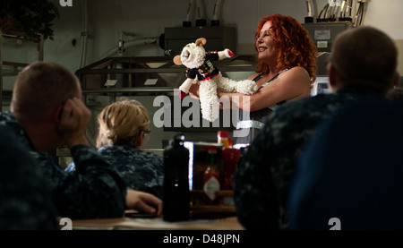 Mallory Lewis performs with Lamb Chop aboard USS Carl Vinson. - Stock Image
