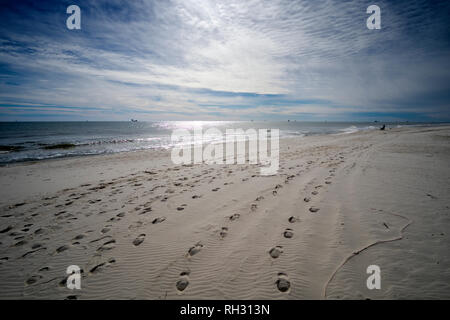 Surf fishing from the beach on a nice January day at Fort Morgan, Alabama, USA - Stock Image