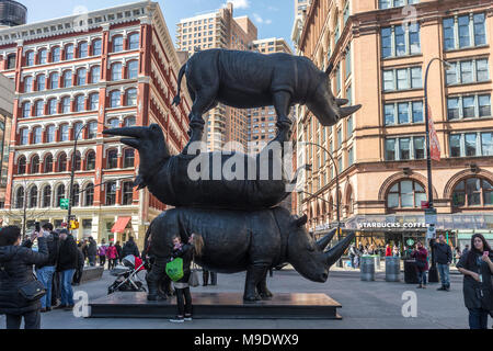 New York, NY, USA 24 March 2018 - New Yorkers flock to see a massive sculpture of three northern white rhinos in Astor Place entitled 'Goodbye Rhinos - The Last Three' It represents Sudan, Najin and Fatu.  the last living animals of a species that is now extinct in the wild. - Stock Image