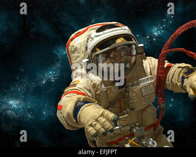 A cosmonaut floats in deep space against a background of stars and nebula. - Stock Image