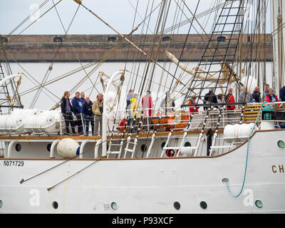 Crew and passengers on the Norwegian three mast sail training ship Christian Radich arriving in Roker Harbour Sunderland for the Tall Ships Race 2018 - Stock Image