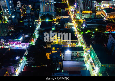 Manila, Philippines - November 11, 2018: Night view of the illuminated streets of the Malate district from above on November 11, 2018, in Metro Manila. - Stock Image