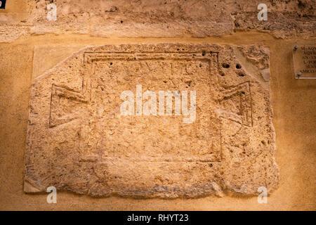 Old roman measure on the Archbishop's Palace wall under the Arch de la calle de la barchilla, Valencia Spain - Stock Image