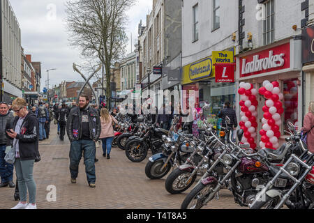 Harley Davidson motor bikes lining Abington Street in the town centre of Northampton, UK; part of an annual charity fund raiser - Stock Image