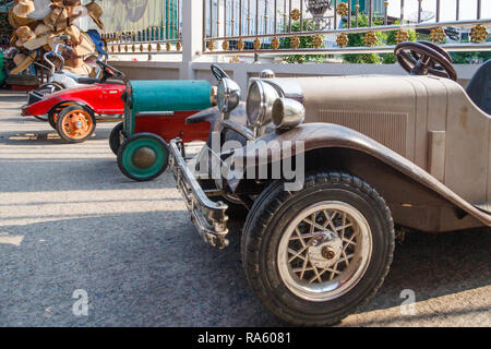 Row of antique pedal cars for sale, Damnoen Saduak, Thailand - Stock Image
