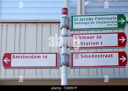 Street sign in Haarlem, the Netherlands. The sign includes a pointer to Santiago de Compostela and the St James' Way Cycling Route. - Stock Image