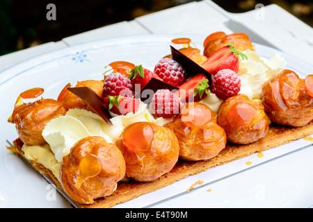gourmet cream cake with raspberries and strawberries - Stock Image