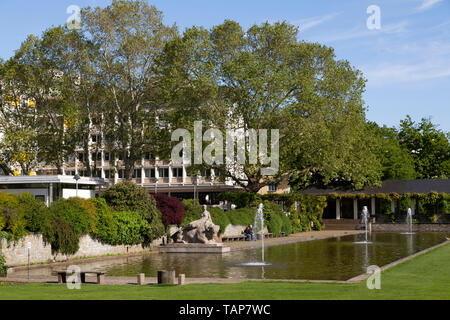 Fountains at the Herbertanlange in Wiesbaden, the state capital of Hesse, Germany. The park is seen in springtime. - Stock Image