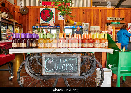 Rural country store display of old fashion apple cider, peach cider and muscadine cider in Pike Road Alabama, USA. - Stock Image
