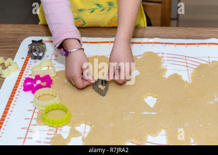 Child cooking traditional cakes for christmas - Stock Image