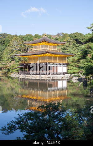 Golden Shinto shrine Kinkakuji centered with water reflection - Stock Image