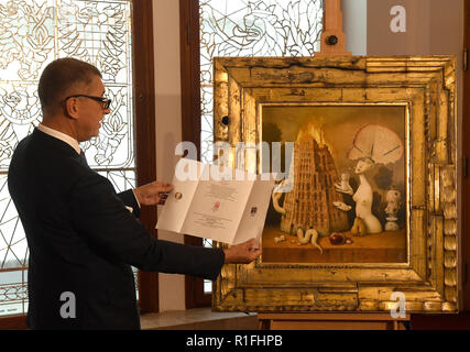 Prague, Czech Republic. 08th Nov, 2018. Czech Prime Minister Andrej Babis gave the painting Visionaries and Arsonists by Zdenek Janda to French President Emmanuel Macron on November 10, 2018, in Paris, France. Babis is attending the 100th celebrations of the end of World War One in Paris. The painting depicting the burning Tower of Babel is Babis's personal gift to Macron. Janda is Babis's friend. On the photo Babis presents the painting to journalists in Prague, Czech Republic, on November 8, 2018. Credit: Michal Krumphzanzl/CTK Photo/Alamy Live News - Stock Image
