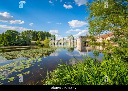 Water mill and bridge across river Gartempe, Saint-Pierre-de-Maillé, France. - Stock Image