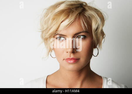 Portrait Handsome Blonde Young Woman Hair Empty White Background.Beauty Fashion People Photo.Pretty Girl Smiling - Stock Image