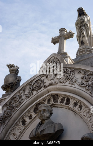 Bust, statues and Crucifix atop a tomb in Recoleta cemetary - Stock Image