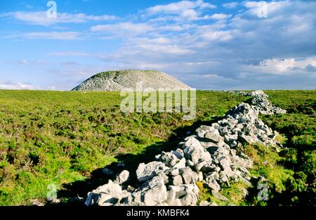 Prehistoric burial mound cairn known as Maeve's Cairn or Maeve's Tump on top of Knocknarea mountain, County - Stock Image