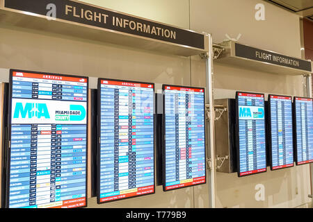 Miami Florida Miami International Airport MIA flight information digital flight information boards arrivals - Stock Image