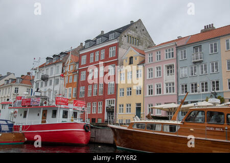 Nyhavn is a 17th centure waterfront, canal and entertainment district in Copenhagen, Denmark. Stretching from Kongens Nytorv to the harbour front and  - Stock Image