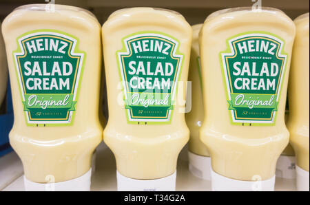 Original Heinz Salad Cream containers on a supermarket shelf in the UK - Stock Image