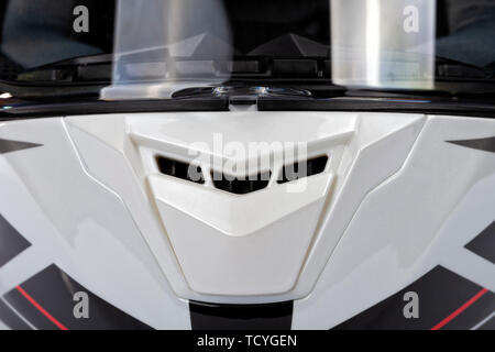 Detail of the front air intake of a white helmet full face of motorcycle - Stock Image