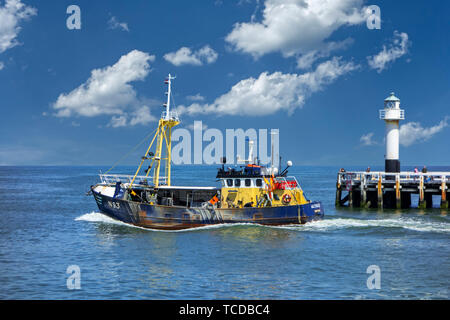 Shrimp trawler / shrimper leaving the Nieuwpoort / Nieuport harbour / port to go fishing for shrimps in the North Sea along the Belgian coast, Belgium - Stock Image