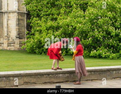 Two oriental ladies looking at mobile phone image Cambridge 2019 - Stock Image