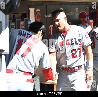 Los Angeles Angels designated hitter Shohei Ohtani and center fielder Mike Trout shake hands in the dugout during the Major League Baseball game against the Minnesota Twins at Target Field in Minneapolis, Minnesota, United States, May 15, 2019. Credit: AFLO/Alamy Live News - Stock Image