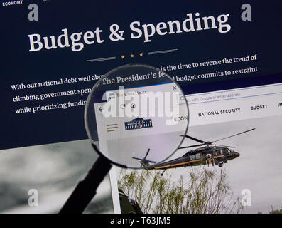 MONTREAL, CANADA - APRIL 24, 2019 : USA White House Government Budget and Spending home page under magnifying glass. Whitehouse.gov is the official th - Stock Image