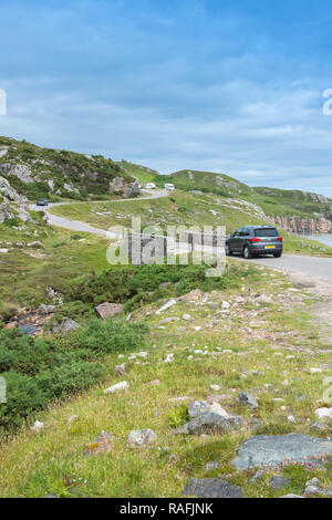 Car driving on the North Coast 500 scenic route near Durness in Sutherland, Scotland - Stock Image