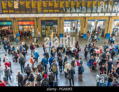 Rail Passengers,Watching,Departure Boards,Kings Cross Station,London,England - Stock Image