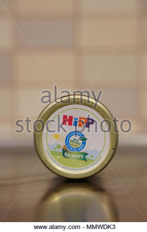 Lying Hipp baby food jar showing Bio logo and 60 years info on cover - Stock Image