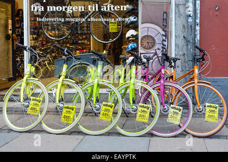 Colorful bicycles on a bicycle shop in Copenhagen, Denmark, Europe - Stock Image