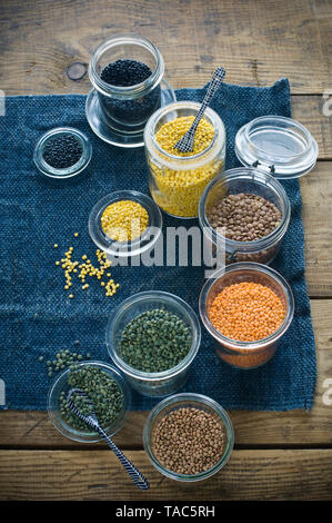 Preserving jars with various sorts of lentils - Stock Image