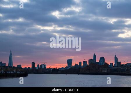 London skyline at sunset with apartment blocks - Stock Image