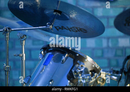 Part of a drumkit, blue tinted drum kit, Paiste cymbals - Stock Image