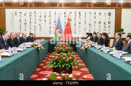 Beijing, China. 24th Apr, 2019. Wang Yang, chairman of the Chinese People's Political Consultative Conference National Committee, meets with Azerbaijani President Ilham Aliyev ahead of the Second Belt and Road Forum for International Cooperation in Beijing, capital of China, April 24, 2019. Credit: Gao Jie/Xinhua/Alamy Live News - Stock Image