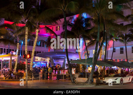 Colorful lights and fast cars; Clevelander Hotel and Nightclub outdoor patio bar on Deco Drive, South Beach Miami, - Stock Image