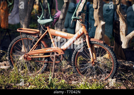 Bodrum, Turkey - January, 2019: Old rusty bicycle for children used as a decorative object in a garden. Editorial. - Stock Image