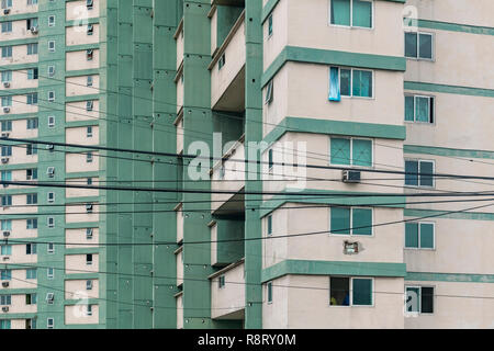 Closeups of the teal-painted, brutalist FOCSA building in Havana Cuba. Shaped like a boomerang. - Stock Image