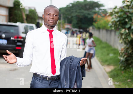 Young man standing out with arms outstretched to welcome someone. - Stock Image